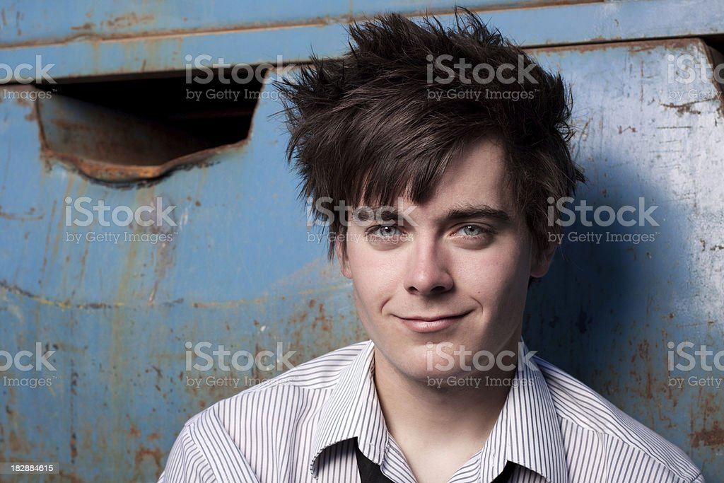 Young Man Wearing Dress Shirt in Grunge Setting royalty-free stock photo