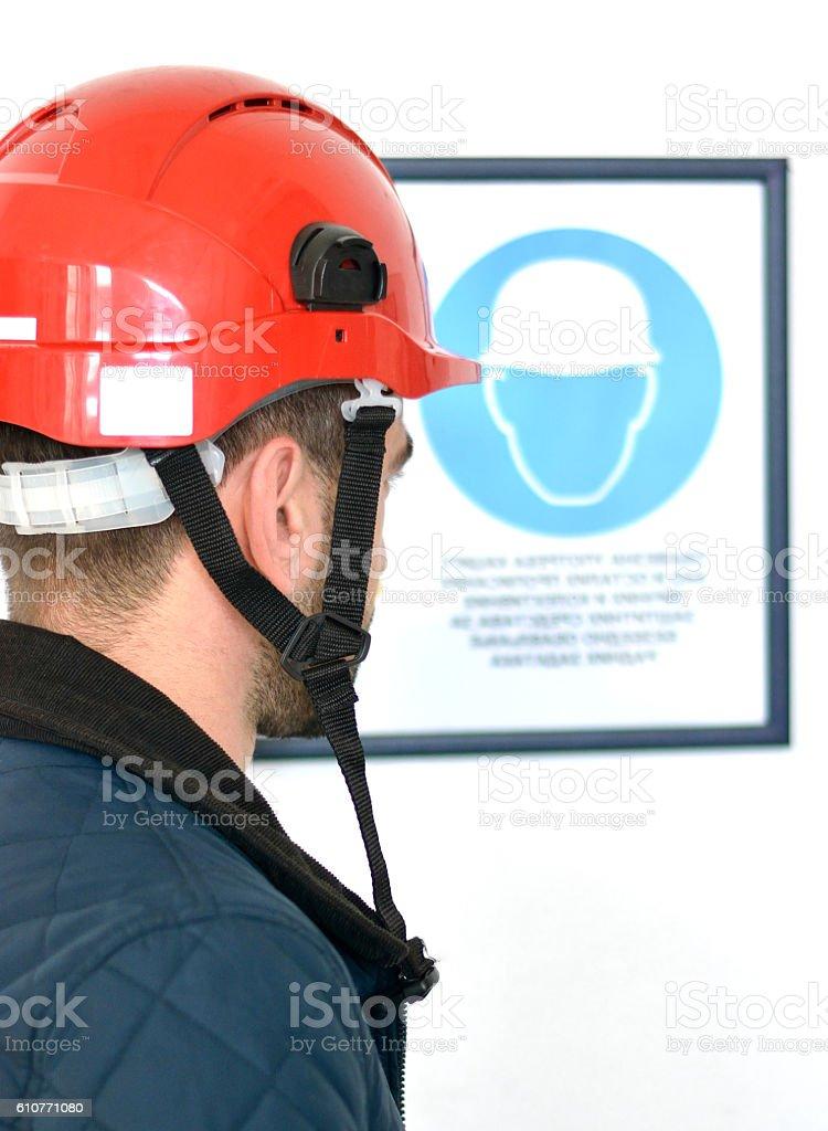 Young man wearing hardhat stock photo