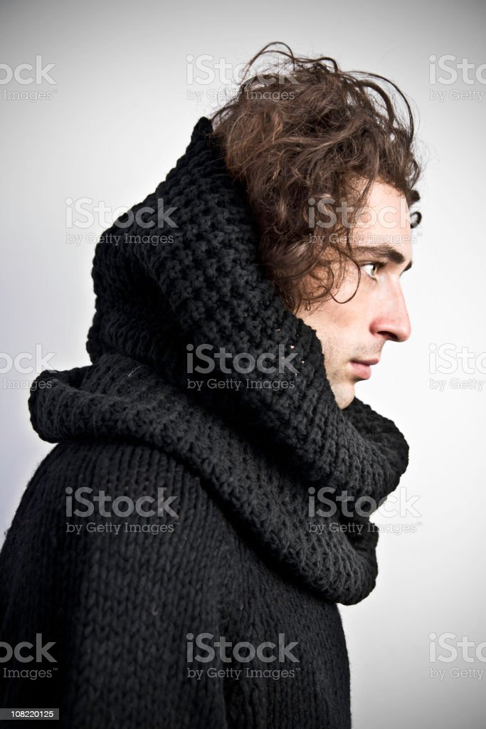 Young Man Wearing Large Wool Cowl Neck Sweater, Side View stock photo