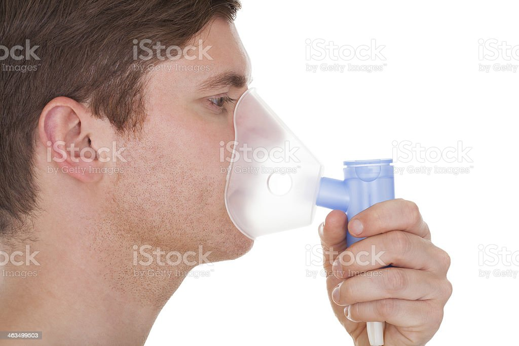 Young Man Wearing Oxygen Mask stock photo