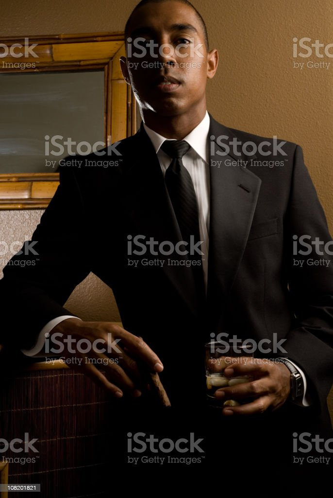 Young Man Wearing Suit and Drinking royalty-free stock photo