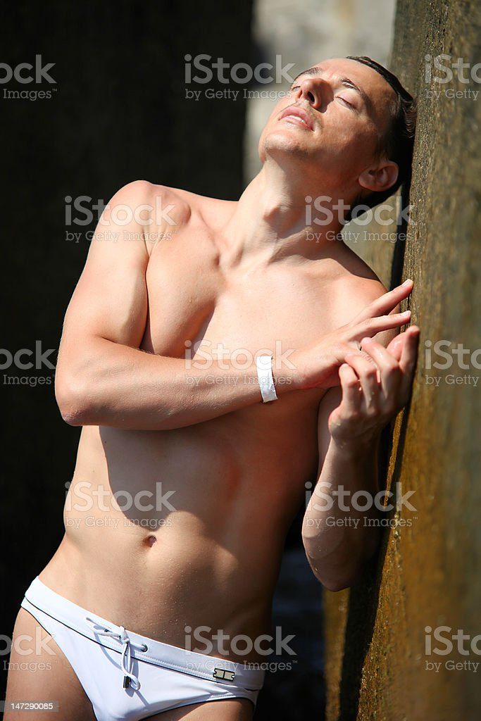 Young man wearing swimming trunks in the sun royalty-free stock photo
