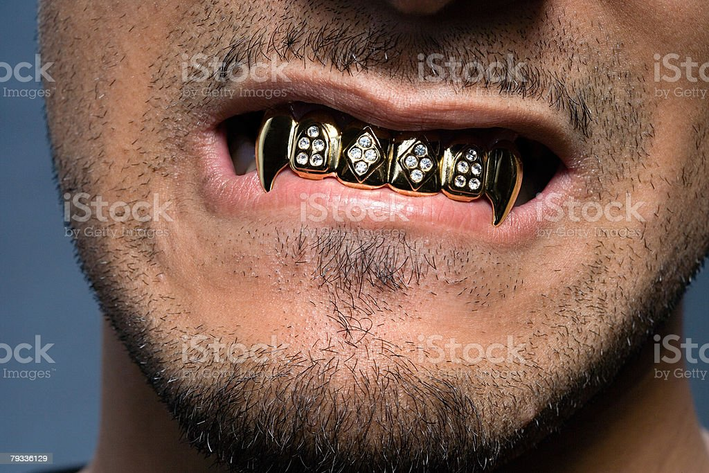 Young man wearing teeth grill stock photo