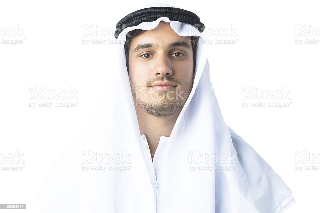 young man wearing traditional arabic clothing stock photo
