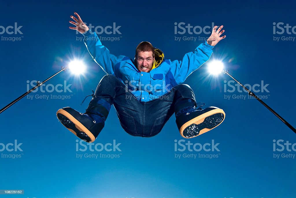 Young man Wearing Winter Jacket and Boots Jumping High royalty-free stock photo