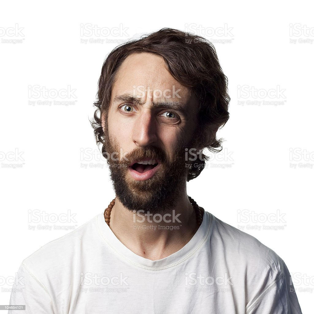 A young man with a beard looking confused royalty-free stock photo