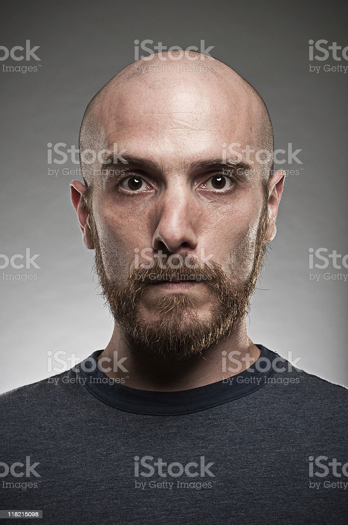 A young man with a beard posing for a portrait stock photo