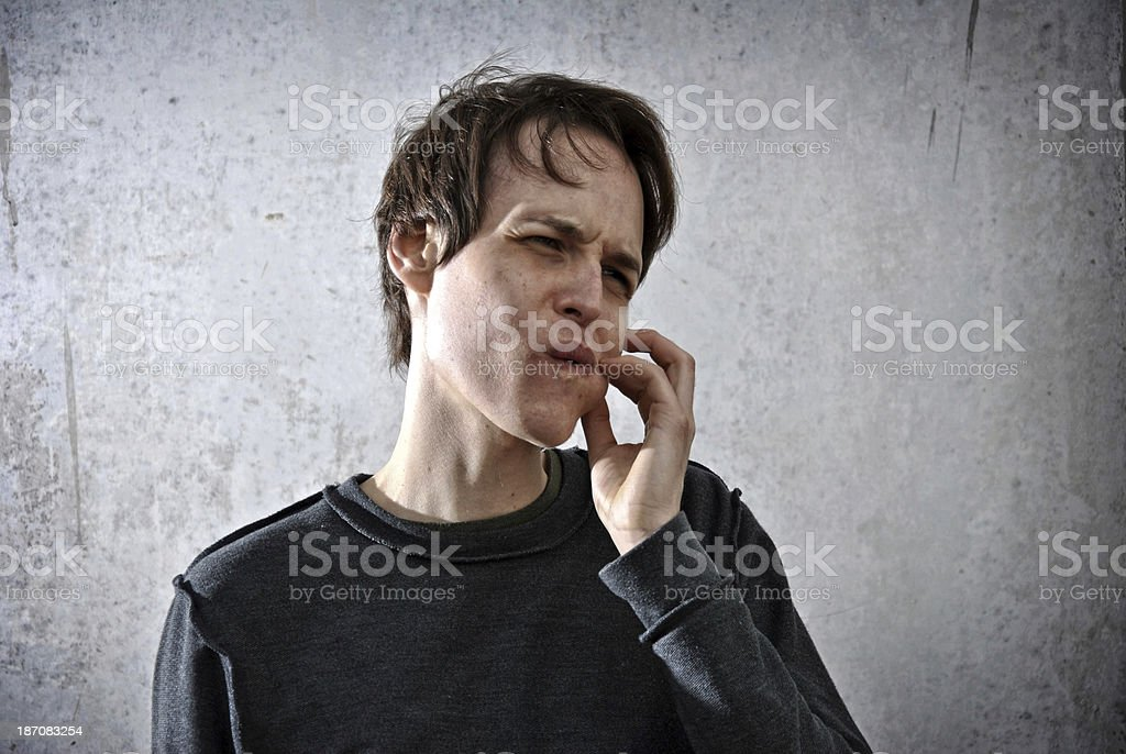 young man with a big toothache stock photo