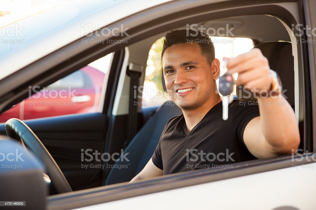 Young man with a brand new car stock photo