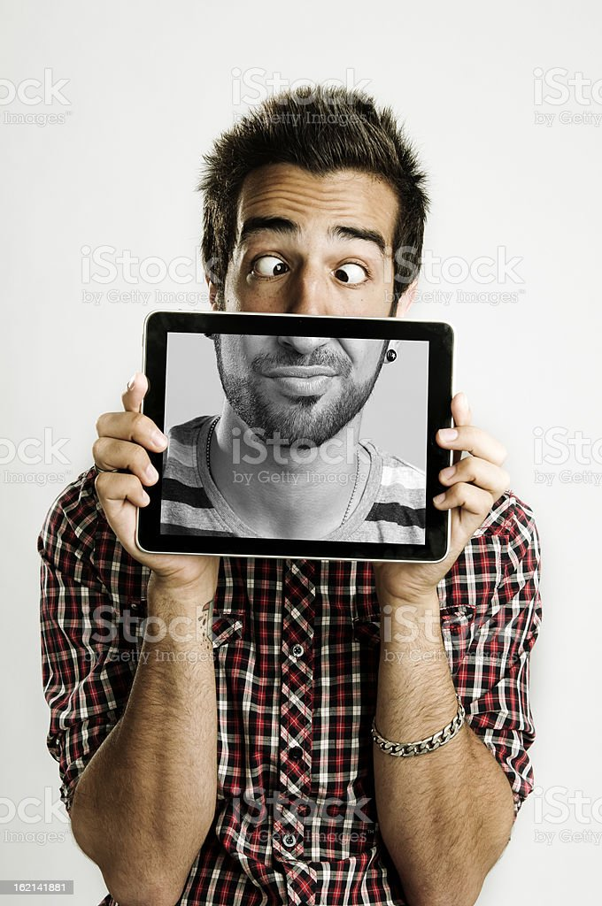 young man with a digital tablet stock photo