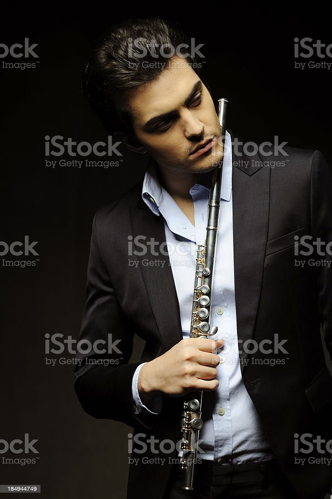 Young man with a flute royalty-free stock photo