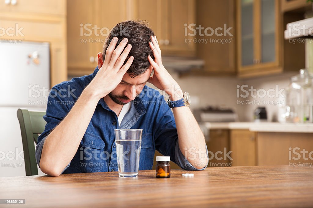 Young man with a headache stock photo