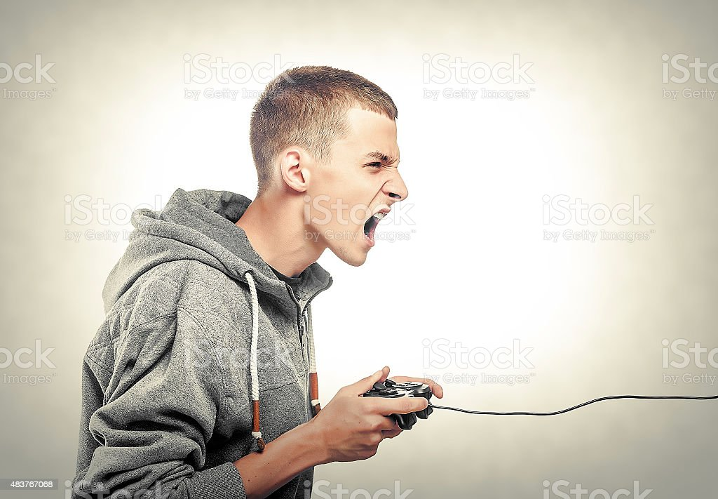 Young man with a joystick stock photo