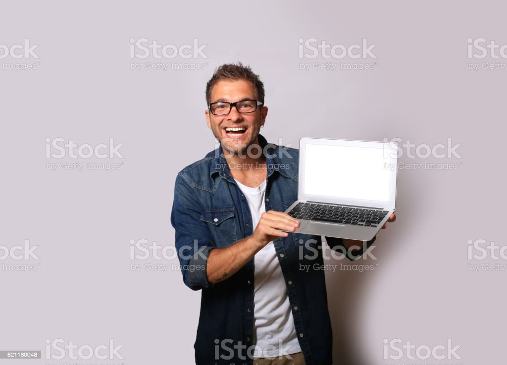 Young man with a laptop stock photo