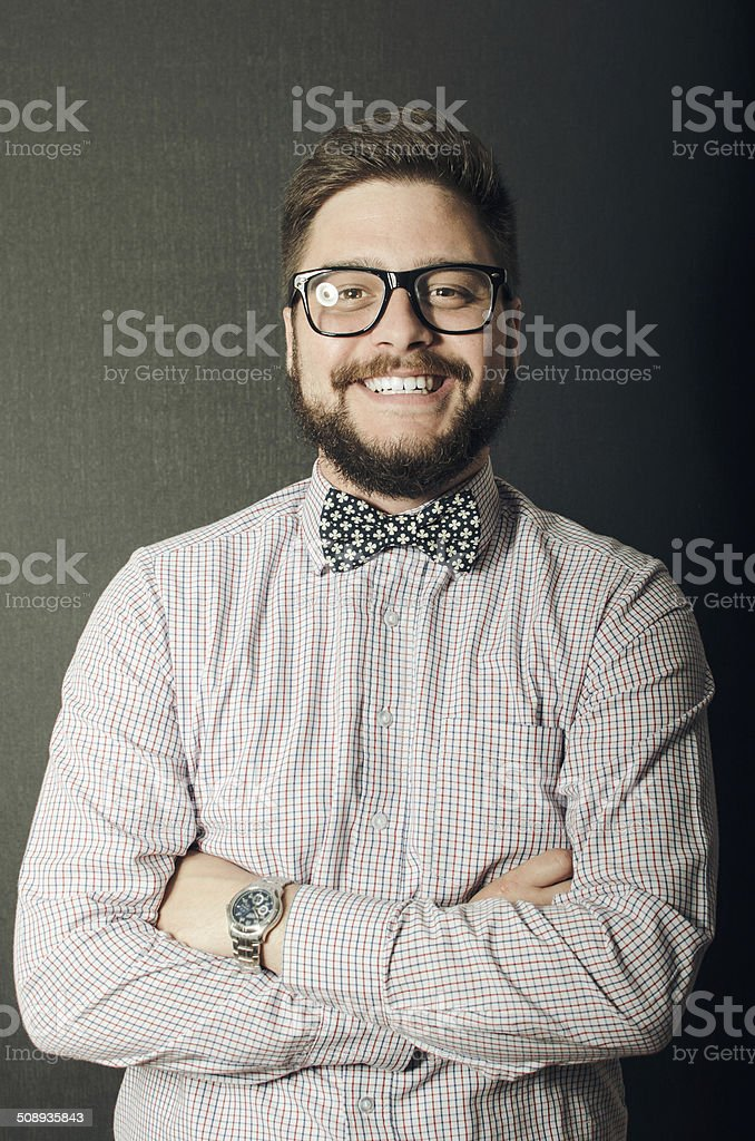 Young man with a nerdy look smiling at the camera stock photo