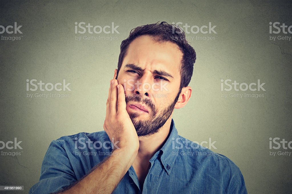 young man with a toothache tooth pain stock photo