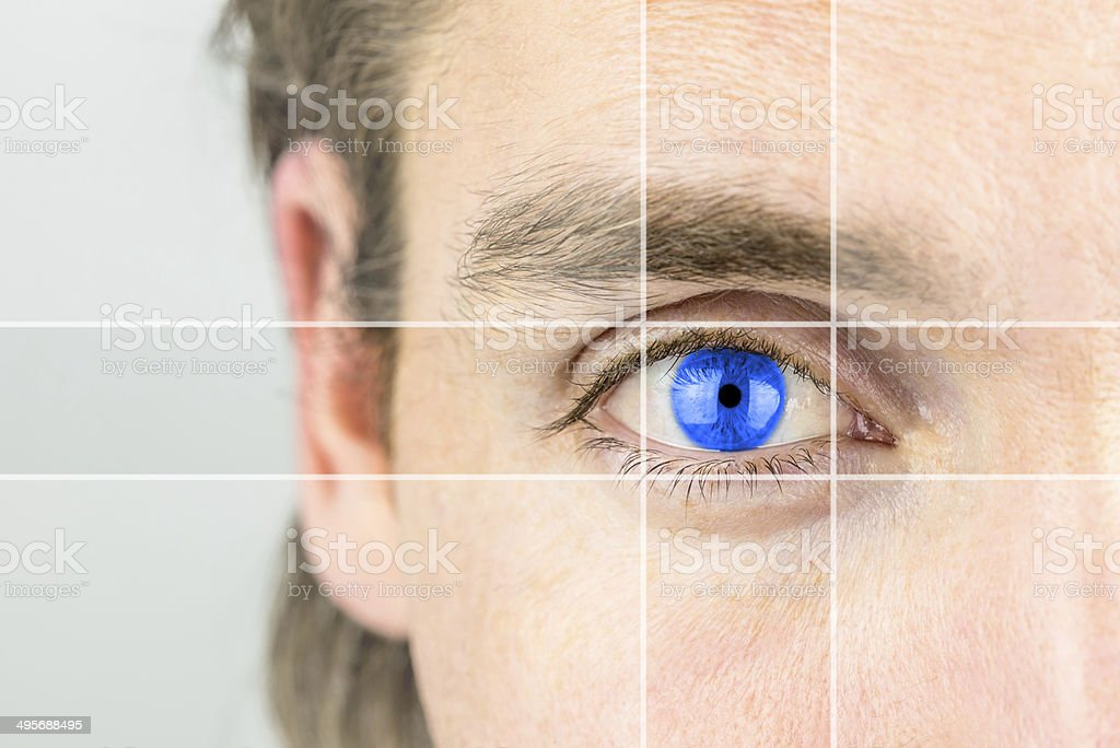 Young man with a vivid blue eye stock photo