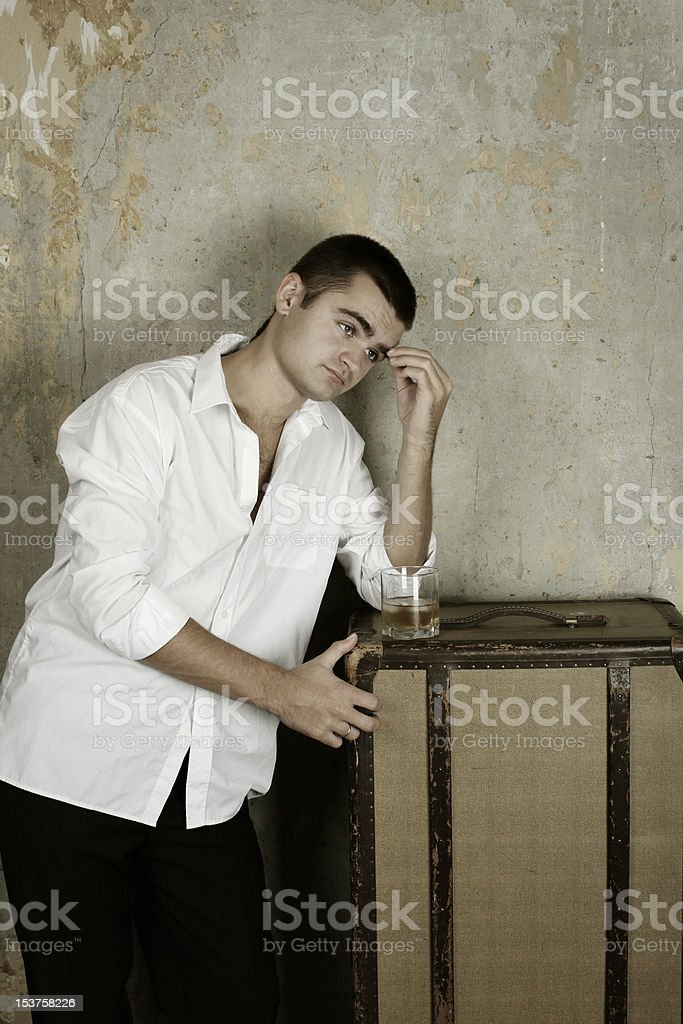 Young man with a whiskey royalty-free stock photo