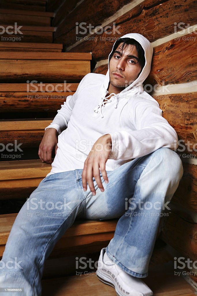 Young Man with a White Hooded Sweatshirt royalty-free stock photo