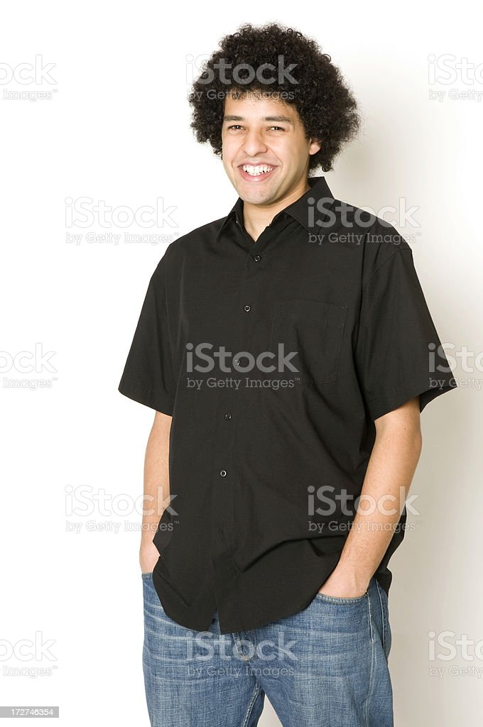 Young man with Afro posing with a smile stock photo