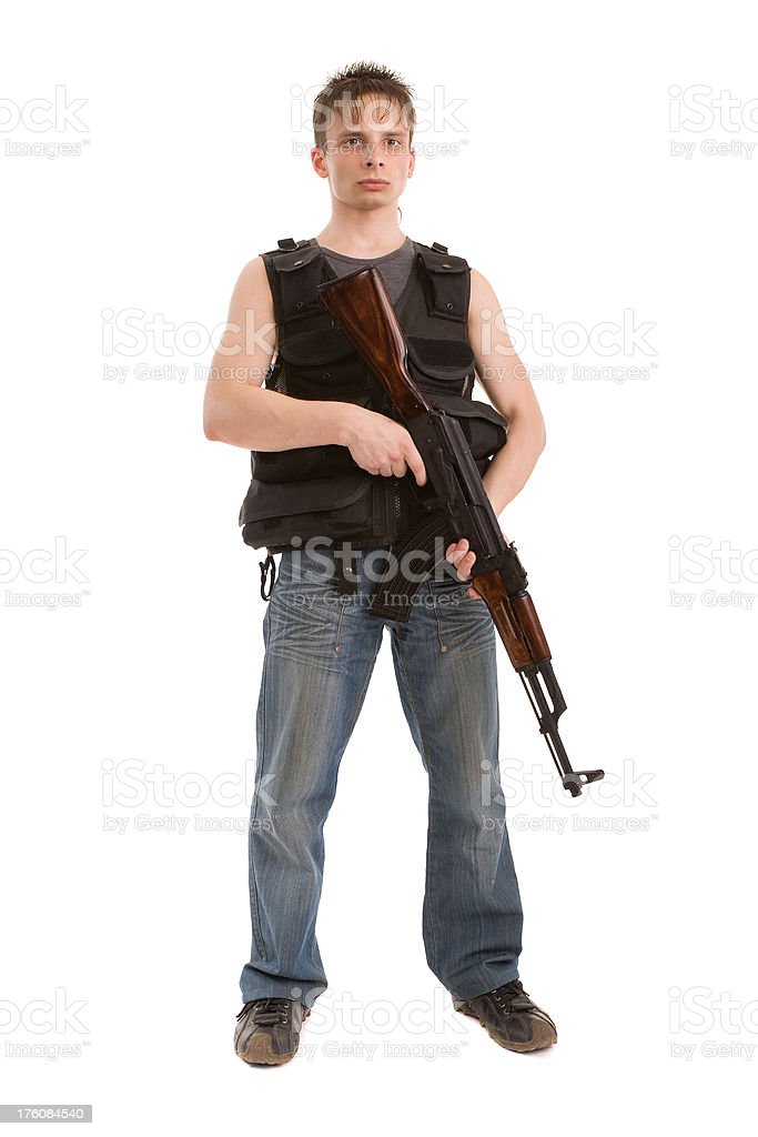 Young man with AKM automatic rifle stock photo
