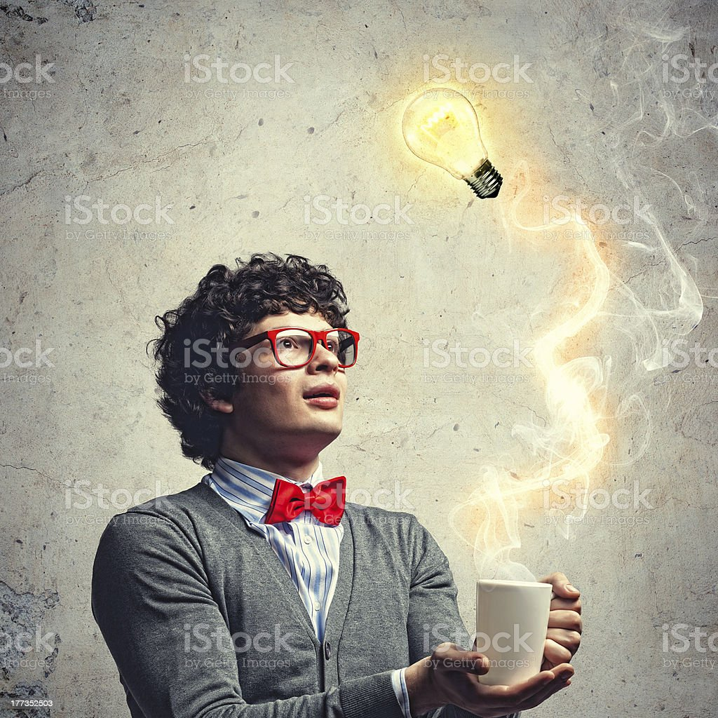 Young man with an electric bulb stock photo