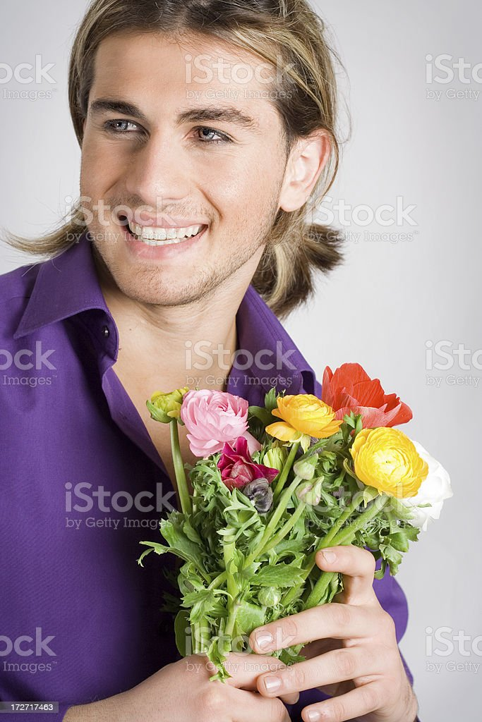 Young man with anemones royalty-free stock photo