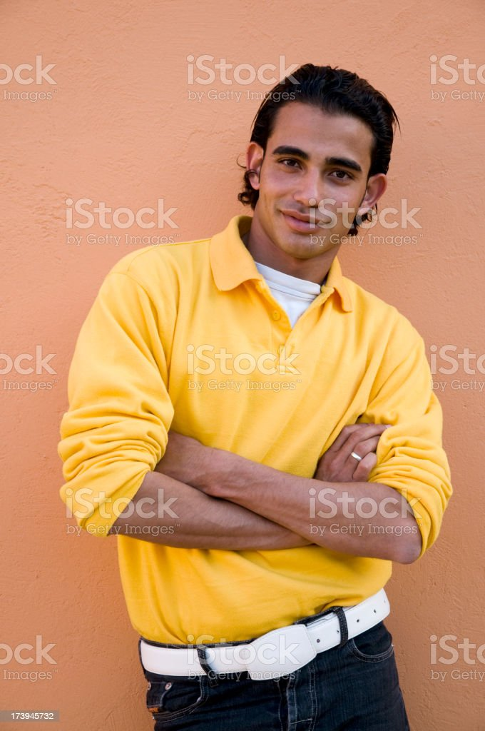 young man with arms crossed royalty-free stock photo