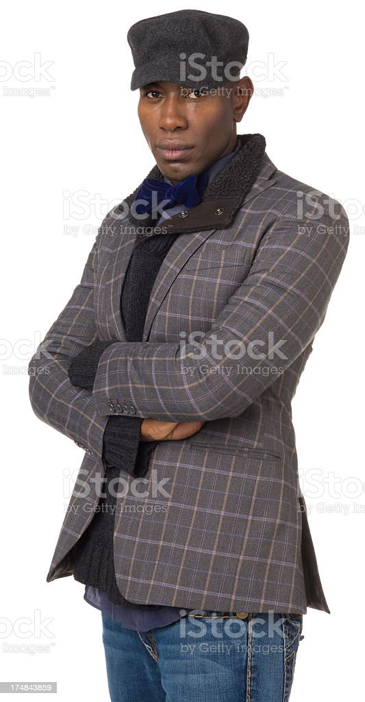 Young Man With Arms Crossed Staring At Camera royalty-free stock photo
