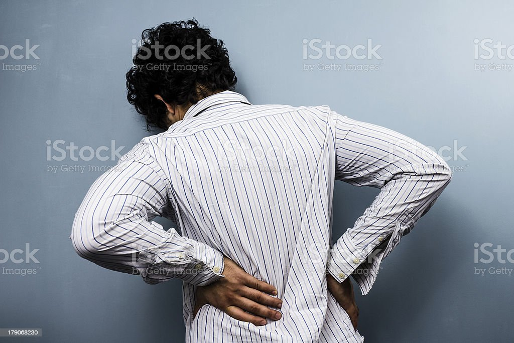 Young man with back pain stock photo