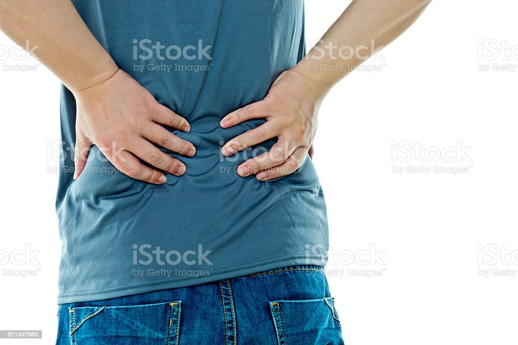 Young man with backache stock photo