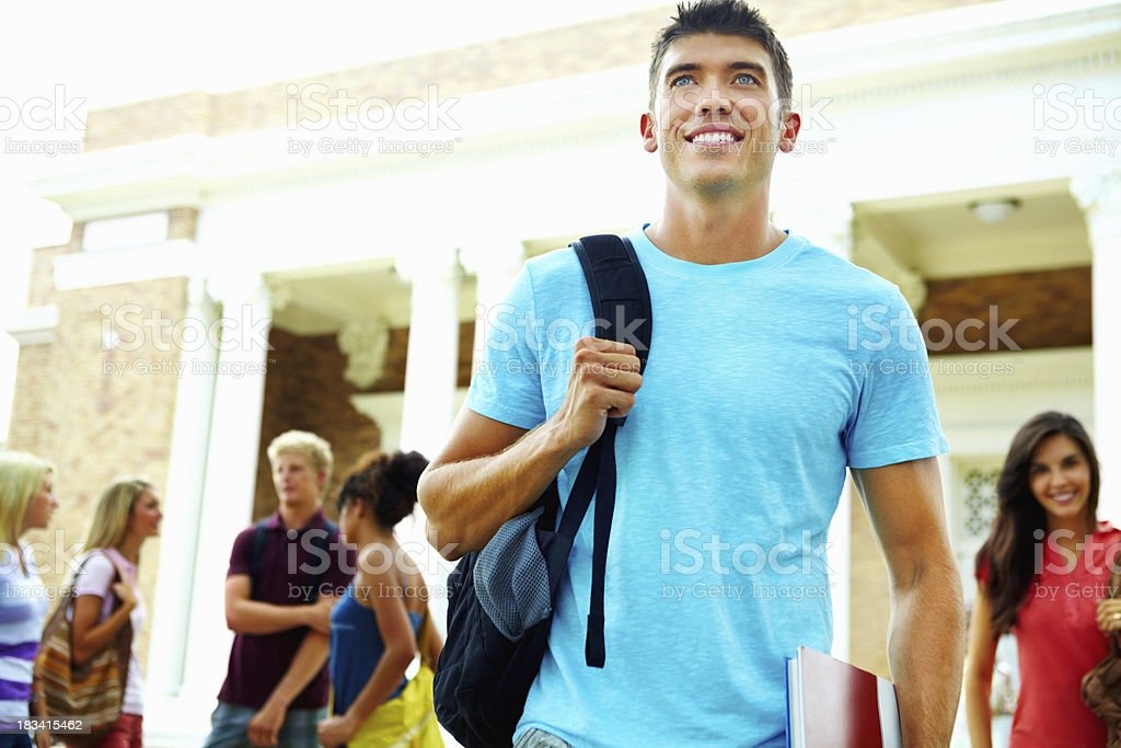Young man with backpack at college campus royalty-free stock photo