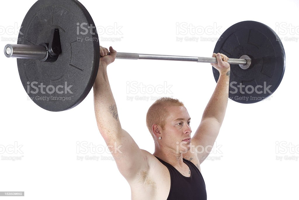 Young man with barbell overhead royalty-free stock photo