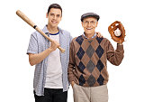 Young man with baseball bat and senior with glove