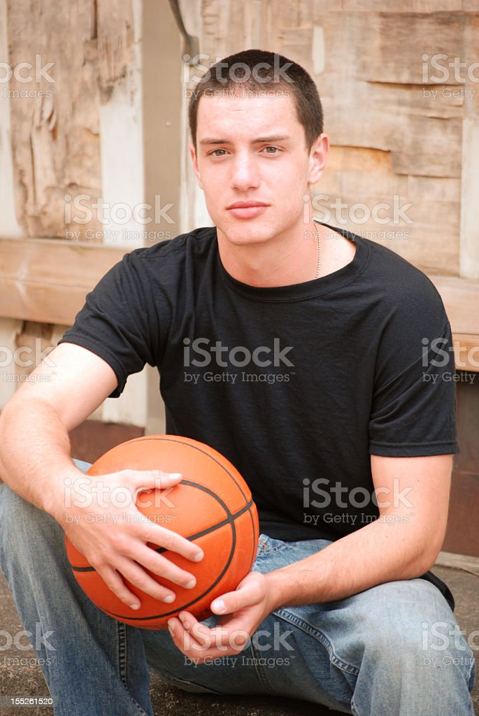 young man with basketball royalty-free stock photo
