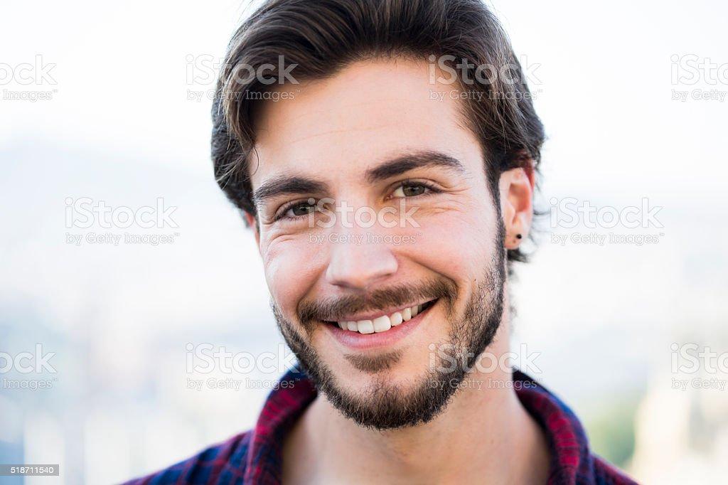 Young man with beard looking at camera. stock photo