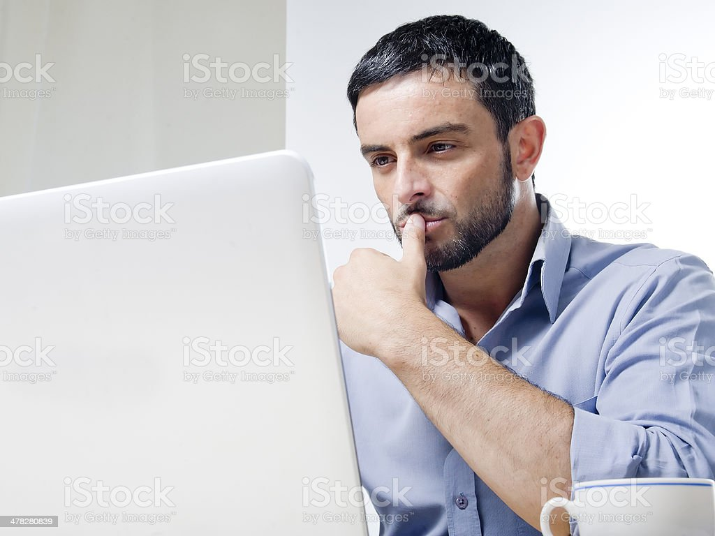 Young Man with Beard working on Laptop royalty-free stock photo