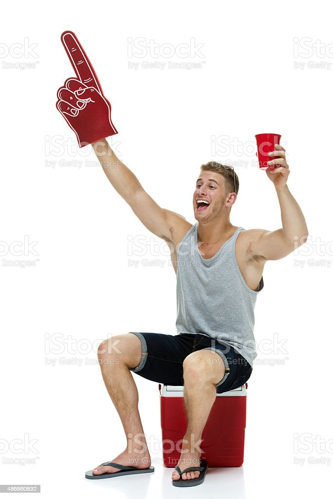 Young man with beer and foam hand stock photo