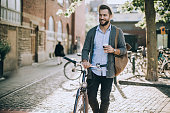 Young man with bicycle