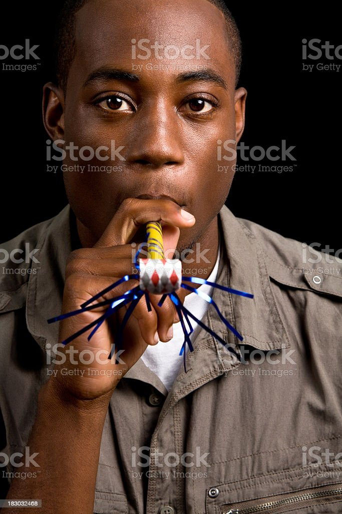 Young Man With Blow-Out Toy stock photo