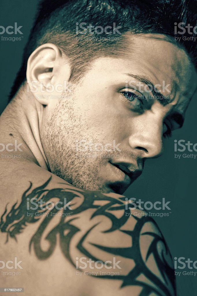 Young man with blue eyes stock photo