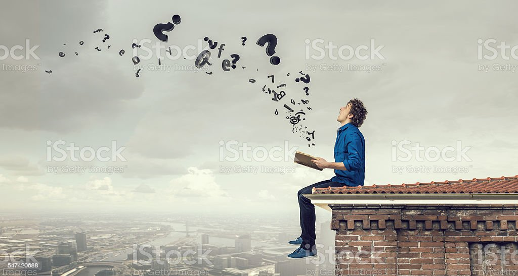 Young man with book . Mixed media stock photo