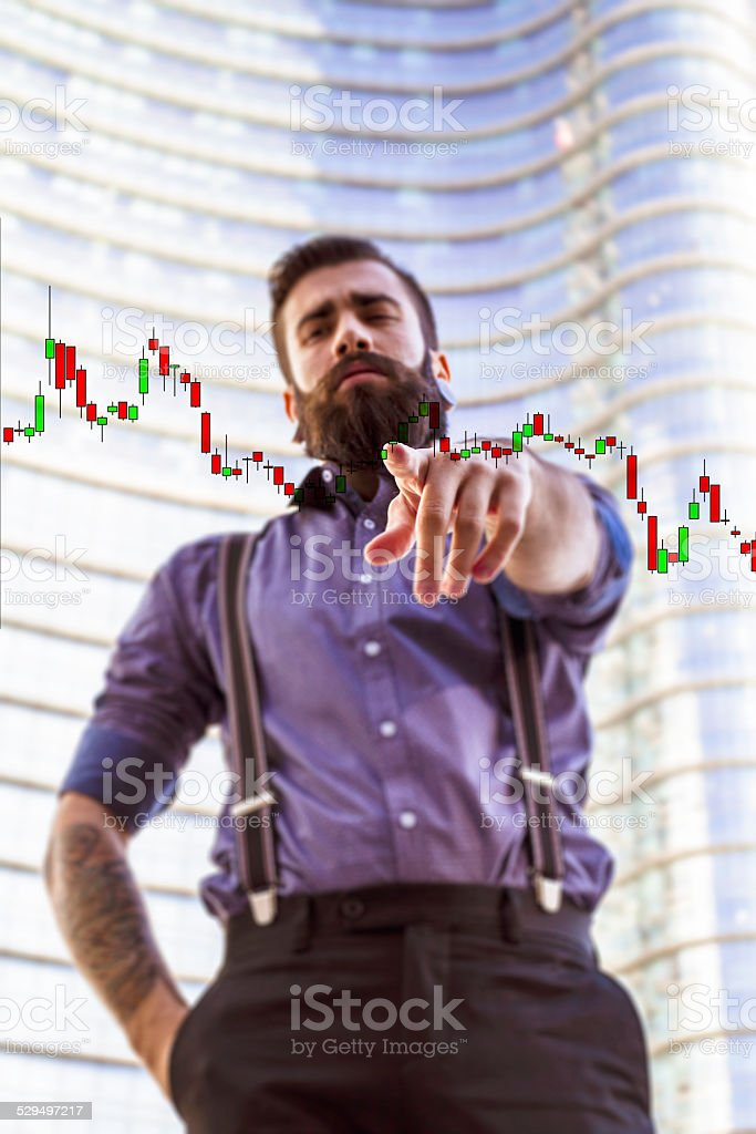 Young man (Hipster style) with candlestick patterns stock photo