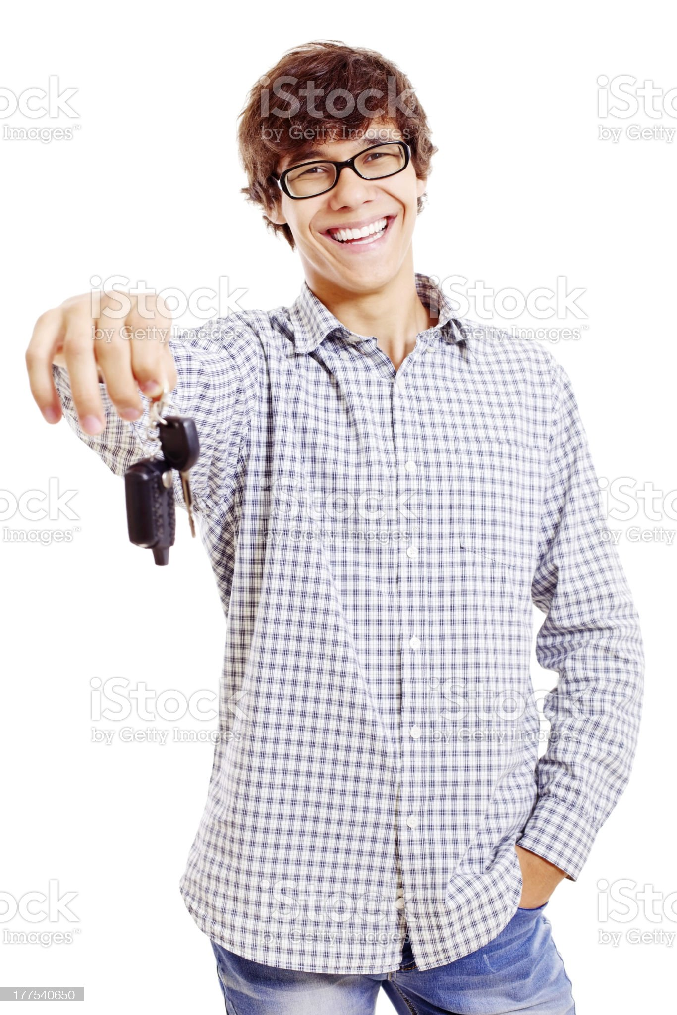 Young man with car keys royalty-free stock photo