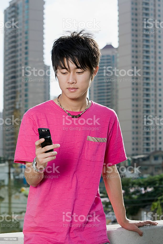 Young man with cellphone royalty-free stock photo