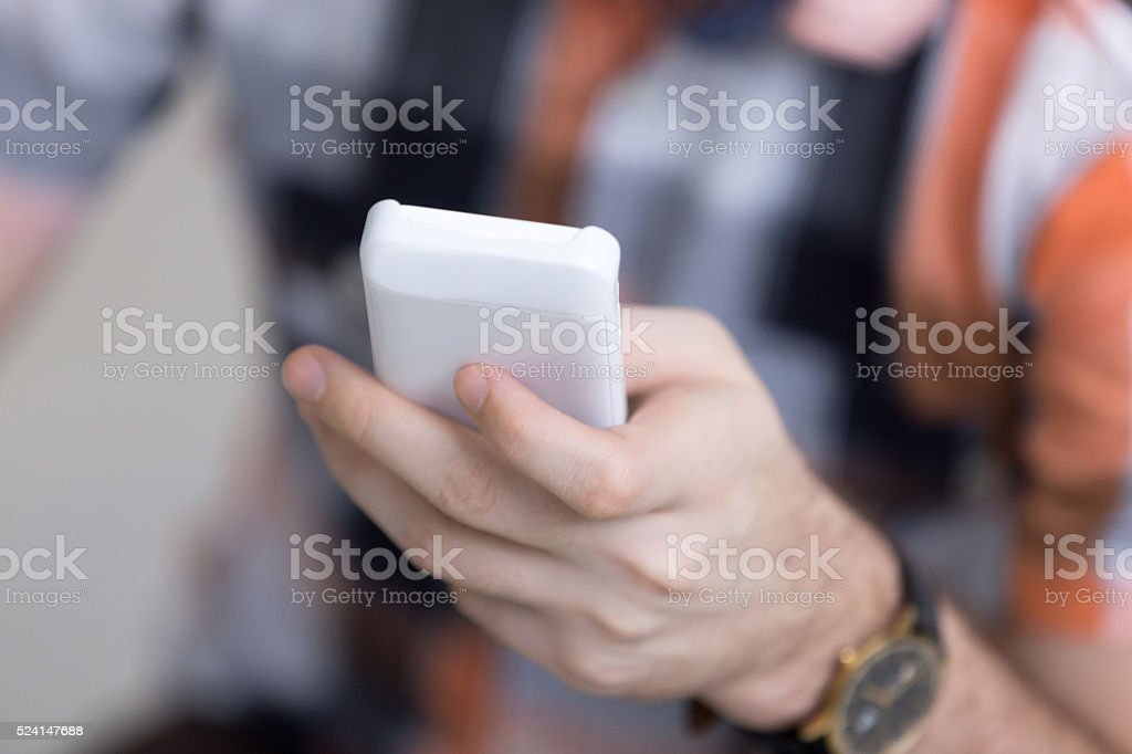 Young man with cellular phone stock photo