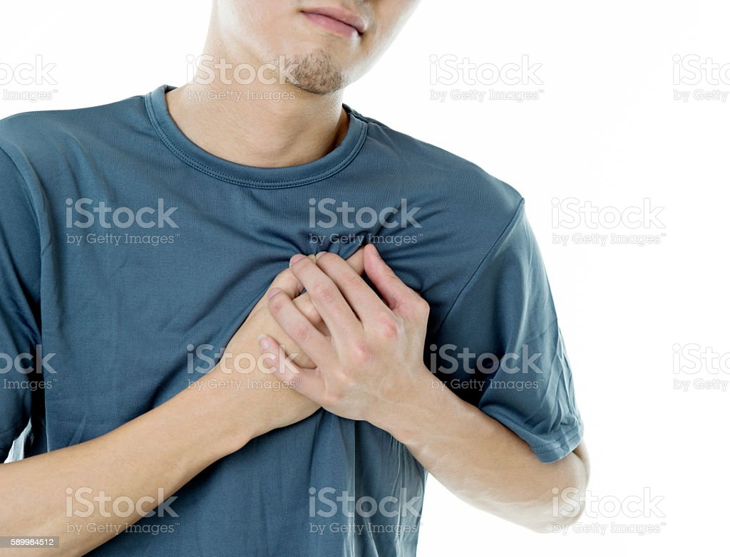 Young man with chest pain stock photo