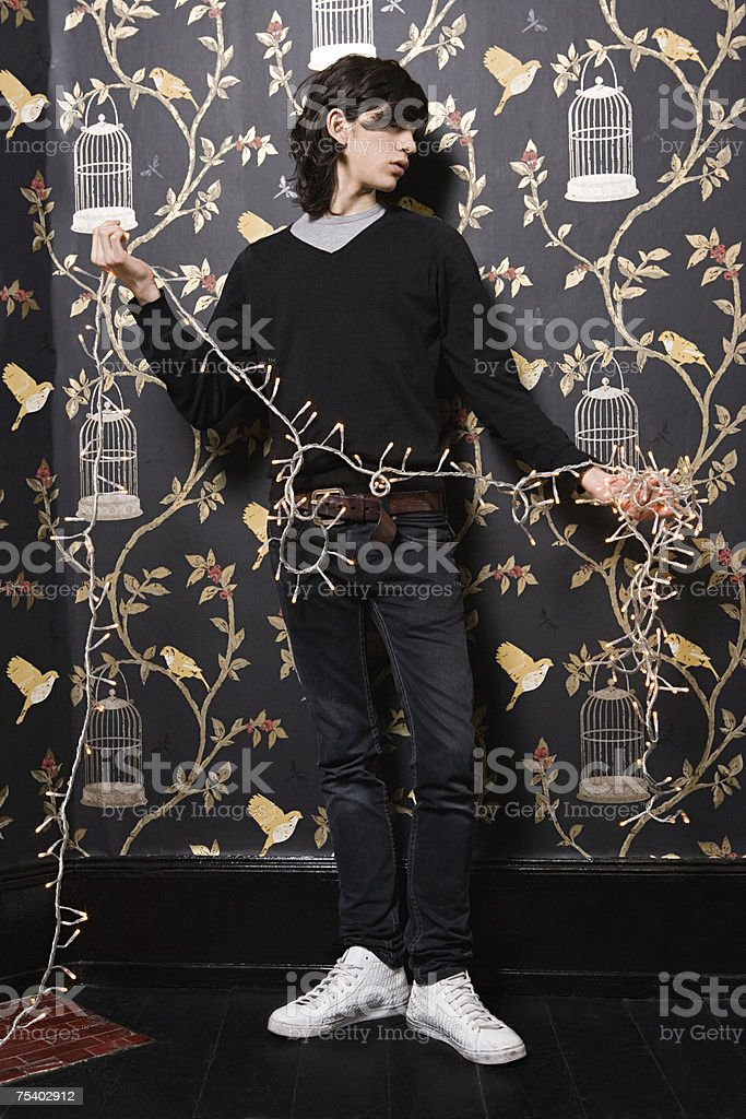 Young man with christmas lights royalty-free stock photo