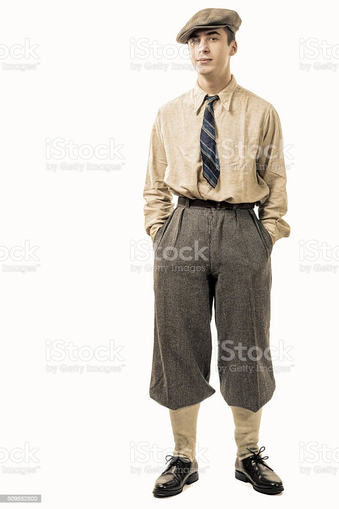 Young man with clothes and cap in 20s style. stock photo