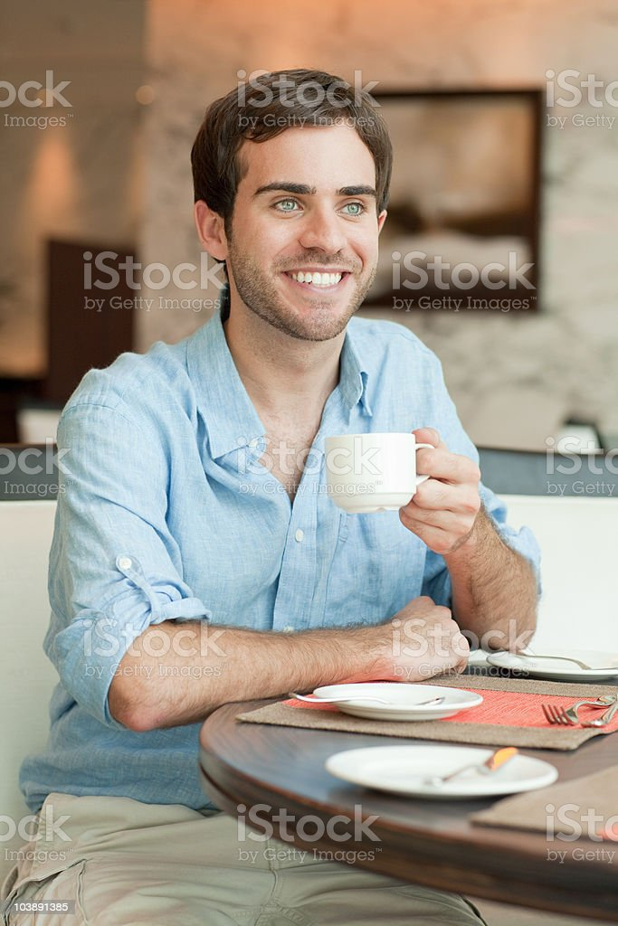 Young man with coffee stock photo